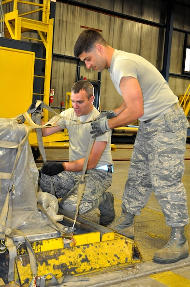 Senior Master Sgts. Brian Cronin, left, and Michael Eonta work together to attach a net to a cargo pallet. The Airmen participated in multiple timed training events throughout the day, designed to bring hands-on practice to Reserve Citizen Airmen of all ranks during the 87th Aerial Port Squadron Port Dawg Challenge conducted May 5, 2018.