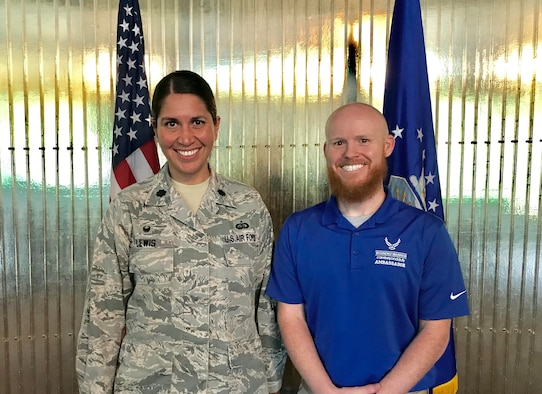 U.S. Air Force Lt. Col. Summer Lewis, 21st Force Support Squadron commander, stands with retired Staff Sgt. Cory Sandoval following a commander's call at Peterson Air Force Base, Colorado, June 4, 2018. Sandoval shared his story with the squadron while sharing how the Air Force Wounded Warrior Program saved his life following a tragic accident several years ago. (U.S. Air Force photo by Alexx Pons)