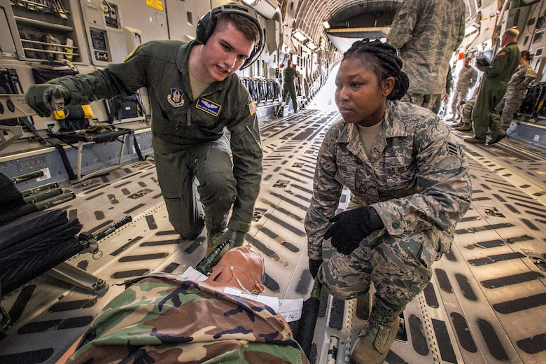 U.S. Air Force Senior Airman Selina N. Okyere, right, and Senior Airman Jacob Patterson, both with the 514th Aeromedical Evacuation Squadron, 514th Air Mobility Wing, prepare to load a patient on a C-17 Globemaster III during an exercise at Joint Base McGuire-Dix-Lakehurst, N.J., June 2, 2018. The 514th is an Air Force Reserve Command unit. (U.S. Air Force photo by Master Sgt. Mark C. Olsen)