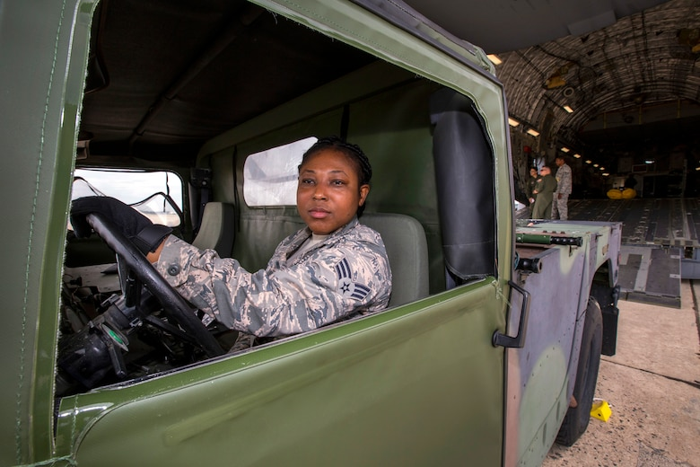 U.S. Air Force Senior Airman Selina N. Okyere, 514th Aeromedical Evacuation Squadron, 514th Air Mobility Wing, parks a Humvee during a patient loading exercise with 514th Aeromedical Evacuation and the 514th Aeromedical Staging Squadrons at Joint Base McGuire-Dix-Lakehurst, N.J., June 2, 2018. The 514th is an Air Force Reserve Command unit. (U.S. Air Force photo by Master Sgt. Mark C. Olsen)
