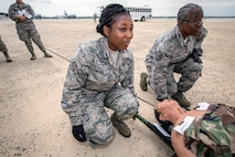 U.S. Air Force Senior Airman Selina N. Okyere, center, and Staff Sgt. Sheran L. McNeil-Johnson, both with the 514th Aeromedical Evacuation Squadron, 514th Air Mobility Wing, participate in a patient loading exercise with 514th Aeromedical Evacuation and the 514th Aeromedical Staging Squadrons at Joint Base McGuire-Dix-Lakehurst, N.J., June 2, 2018. The 514th is an Air Force Reserve Command unit. (U.S. Air Force photo by Master Sgt. Mark C. Olsen)