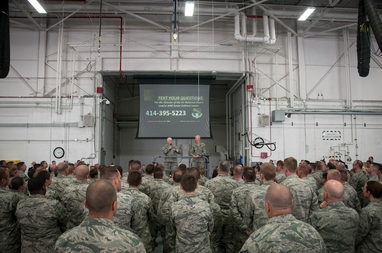 Lt. Gen. L. Scott Rice, the director of the Air National Guard, and Chief Master Sgt. Ronald C. Anderson, command chief master sergeant of the Air National Guard, address Airmen of the 128th Air Refueling Wing, Wisconsin Air National Guard, during a Commander's Call June 3, 2018.