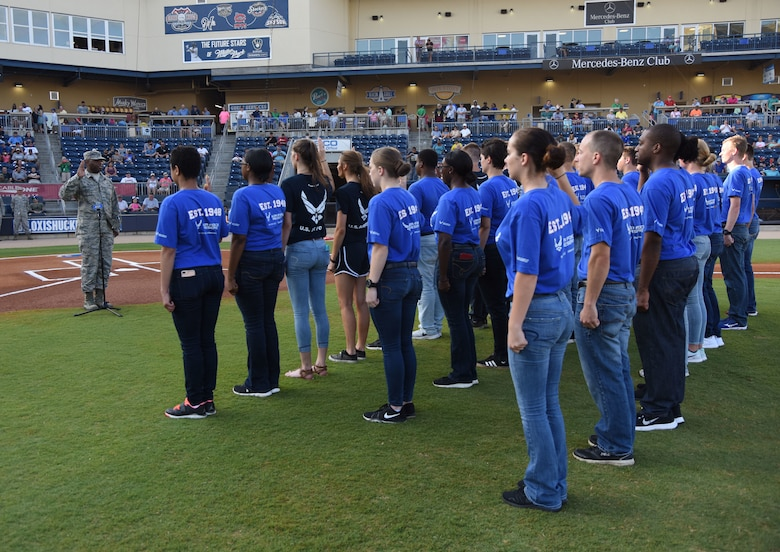 Col. Leo Lawson, Jr., 81st Training Group commander, recites the oath of enlistment to Air Force delayed enlistment program recruits during the Biloxi Shuckers Minor League Baseball team's military appreciation night at MGM Park in Biloxi, Mississippi, June 2, 2018. The Shuckers recognized and honored service members and their families for the dedication, commitment and sacrifices they make for the nation. (U.S. Air Force photo by Kemberly Groue)