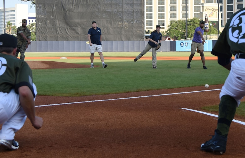 Keesler military members throw ceremonial first pitches during the Biloxi Shuckers Minor League Baseball team's military appreciation night at MGM Park in Biloxi, Mississippi, June 2, 2018. Keesler Airmen and leadership also participated in pre-game festivities that included presenting the colors, flag display and throwing the ceremonial first pitches. (U.S. Air Force photo by Kemberly Groue)
