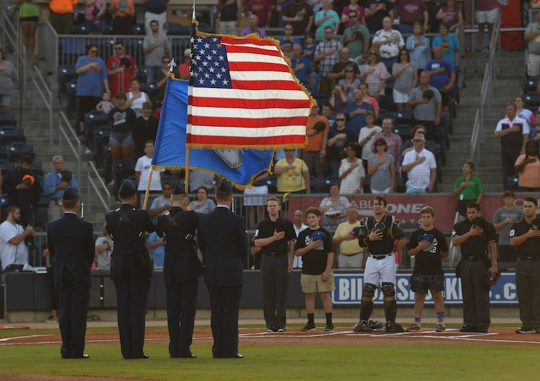 Airmen from the 81st Training Group present the colors during the Biloxi Shuckers Minor League Baseball team's military appreciation night at MGM Park in Biloxi, Mississippi, June 2, 2018. Keesler Airmen and leadership also participated in pre-game festivities that included presenting the colors, flag display and throwing the ceremonial first pitches. (U.S. Air Force photo by Kemberly Groue)