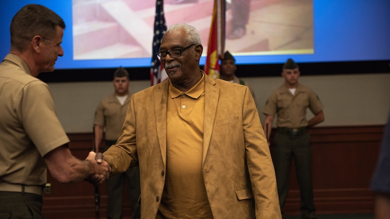 Clement E. Hill shakes hands with Lt. Gen. William D. Beydler, commander of Marine Corps Forces Central Command, after a Congressional Gold Medal Award Ceremony, May 31, 2018 at MacDill Air Force Base, Florida. Hill accepted the award in honor of his late father Pfc. Burnie W. Hill, a Montford Point Marine. In 1942, African Americans were given the opportunity to enlist in the United States Marine Corps. Nearly 20,000 African Americans from 1942-1949 were trained separately from their white counterparts at Montford Point, a facility at Camp Lejeune, North Carolina.