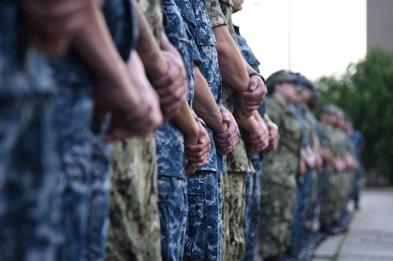Keesler Airmen, Marines and Sailors stand in formation during the Battle of Midway Commemoration Ceremony hosted by the Center for Naval Aviation Technical Training Unit Keesler outside of Allee Hall at Keesler Air Force Base, Mississippi, June 5, 2018. The ceremony commemorated the 76th anniversary of the Battle of Midway, which was a U.S. naval victory during World War II. (U.S. Air Force photo by Kemberly Groue)
