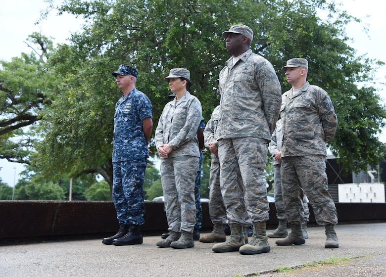 Keesler Airmen and Sailors stand in formation during the Battle of Midway Commemoration Ceremony hosted by the Center for Naval Aviation Technical Training Unit Keesler outside of Allee Hall at Keesler Air Force Base, Mississippi, June 5, 2018. The ceremony commemorated the 76th anniversary of the Battle of Midway. (U.S. Air Force photo by Kemberly Groue)