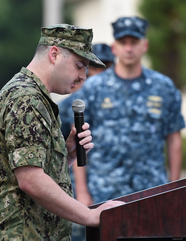 U.S. Navy Aerographers Mate 1st Class Zachary Walt, Center for Naval Aviation Technical Training Unit Keesler instructor, delivers remarks during the Battle of Midway Commemoration Ceremony hosted by the CNATTU Keesler outside of Allee Hall at Keesler Air Force Base, Mississippi, June 5, 2018. The ceremony commemorated the 76th anniversary of the Battle of Midway. (U.S. Air Force photo by Kemberly Groue)