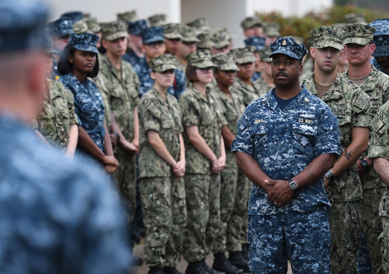 U.S. Navy Chief Electricians Mate Andre Syas, Center for Naval Aviation Technical Training Unit Keesler calibration department lead, stands in formation during the Battle of Midway Commemoration Ceremony hosted by the CNATTU Keesler outside of Allee Hall at Keesler Air Force Base, Mississippi, June 5, 2018. The ceremony commemorated the 76th anniversary of the Battle of Midway. (U.S. Air Force photo by Kemberly Groue)