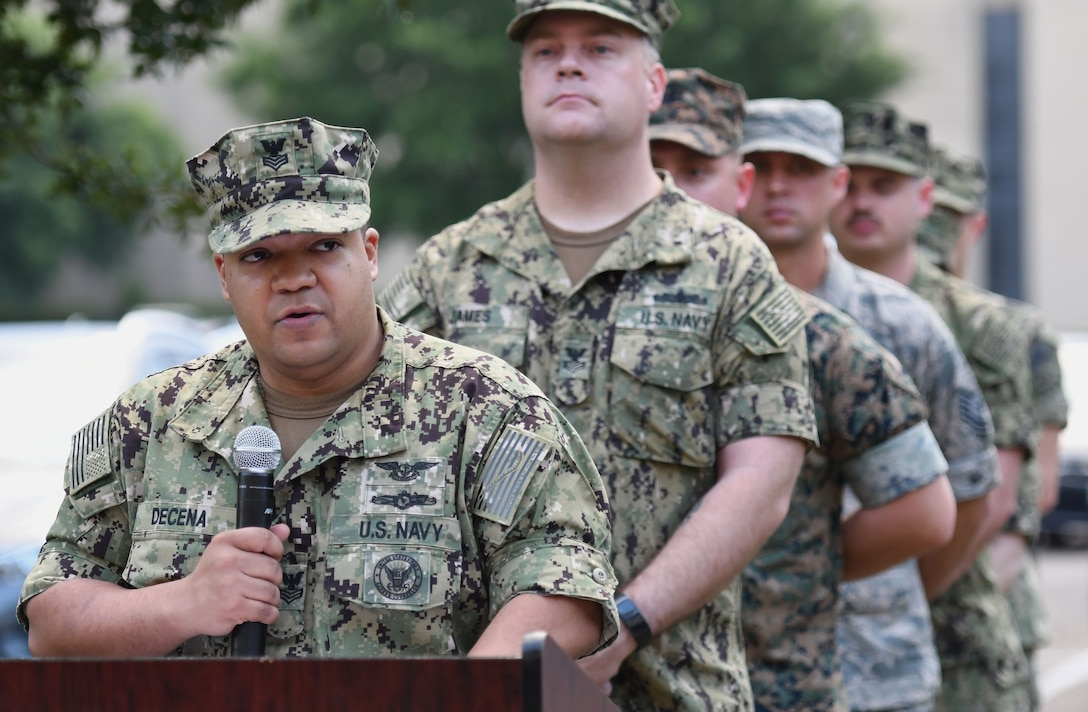 U.S. Navy Aviation Electronics Technician 1st Class Miguel Decena, Center for Naval Aviation Technical Training Unit Keesler advanced calibration lead, delivers remarks during the Battle of Midway Commemoration Ceremony hosted by the CNATTU Keesler outside of Allee Hall at Keesler Air Force Base, Mississippi, June 5, 2018. The ceremony commemorated the 76th anniversary of the Battle of Midway, which was a U.S. naval victory during World War II.  (U.S. Air Force photo by Kemberly Groue)