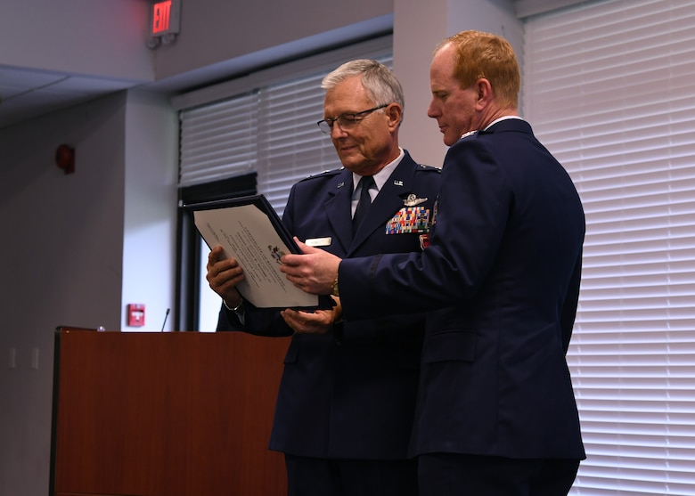 Maj. Gen. John Howlett, United States Air Force, retired, and Col. James Kellogg, Jr., 94th Airlift Wing vice commander, hold Kellogg's certificate of retirement at Dobbins Air Reserve Base, Ga, June 2, 2018. Howlett attended Kellogg's retirement ceremony as the presiding official, and talked about his time with Kellogg. (U.S. Air Force photo by Staff Sgt. Miles Wilson)