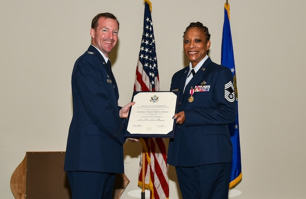 Col. Edward Segura, 403rd Mission Support Group commander, presents the Certificate of Retirement to Chief Master Sgt. Sybil McDowell, 403rd Force Support Squadron superintendent.