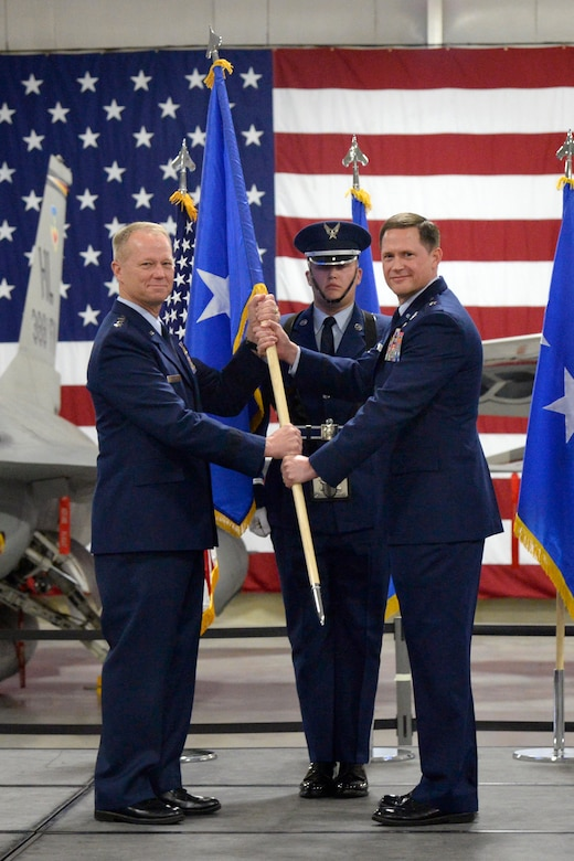 Lieutenant General Mark D. Kelly, 12th Air Force commander, presents the one star flag to Brig. Gen. David B. Lyons, 12th Air Force vice commander, during Lyons' promotion ceremony from colonel to brigadier general May 30, 2018, at Hill Air Force Base, Utah. (U.S. Air Force photo by Todd Cromar)