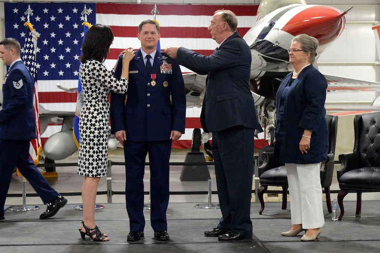 Family members pin new rank on Brig. Gen. David B. Lyons, 12th Air Force vice commander, during Lyons' promotion ceremony from colonel to brigadier general May 30, 2018, at Hill Air Force Base, Utah. (U.S. Air Force photo by Todd Cromar)