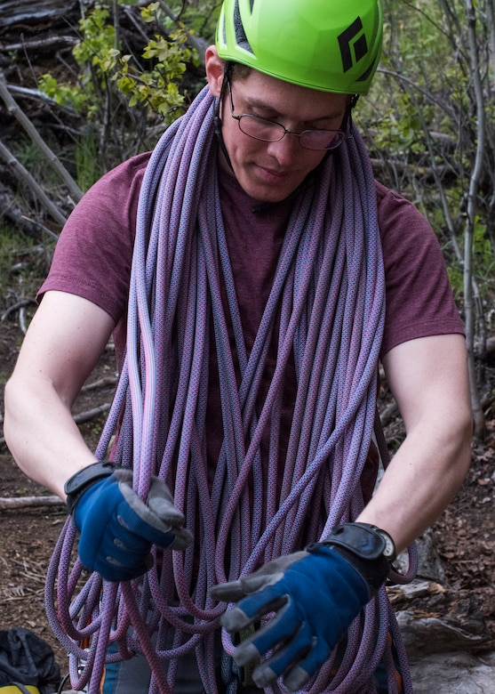 Fernando Martinez Batiz, an Outdoor Adventure Program recreational assistant, gathers climbing rope after an OAP rock-climbing trip at Pivot Point Trail near Anchorage, Alaska, May 31, 2018. Martinez Batiz has been climbing for more than three years and works with OAP on guided events and classes. The OAP offers low-cost opportunities for the Joint Base Elmendorf-Richardson community to explore Alaska while also supporting the development of mission-ready military members.