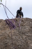 Christian Ortega, an Outdoor Adventure Program recreational assistant, throws climbing rope down after an OAP rock-climbing trip at Pivot Point Trail near Anchorage, Alaska, May 31, 2018. Ortega has been climbing for more than five years and has and internship with OAP on guided events and classes. The OAP offers low-cost opportunities for the Joint Base Elmendorf-Richardson community to explore Alaska while also supporting the development of mission-ready military members.