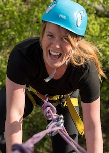 Gwen Nieberlein, a 673d Medical Group Family Advocacy Outreach Manager, celebrates after reaching the top during an Outdoor Adventure Program rock-climbing trip at Pivot Point Trail near Anchorage, Alaska, May 31, 2018. Nieberlein has participated in many of OAP's guided events since being stationed at Joint Base Elmendorf-Richardson. The OAP offers many opportunities year-round for the JBER community to explore Alaska while also supporting the development of mission-ready military families and members.
