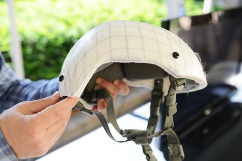 "Representatives of the U.S. Army Natick Soldier Research, Development and Engineering Center, out of Natick, Massachusetts, had an array of combat helmets on display at the Pentagon, May 24 and 25, 2018, as part of a ""Close Combat Lethality Tech Day."" This helmet, a NSRDEC prototype, provides equal protection to earlier helmets but at less weight."