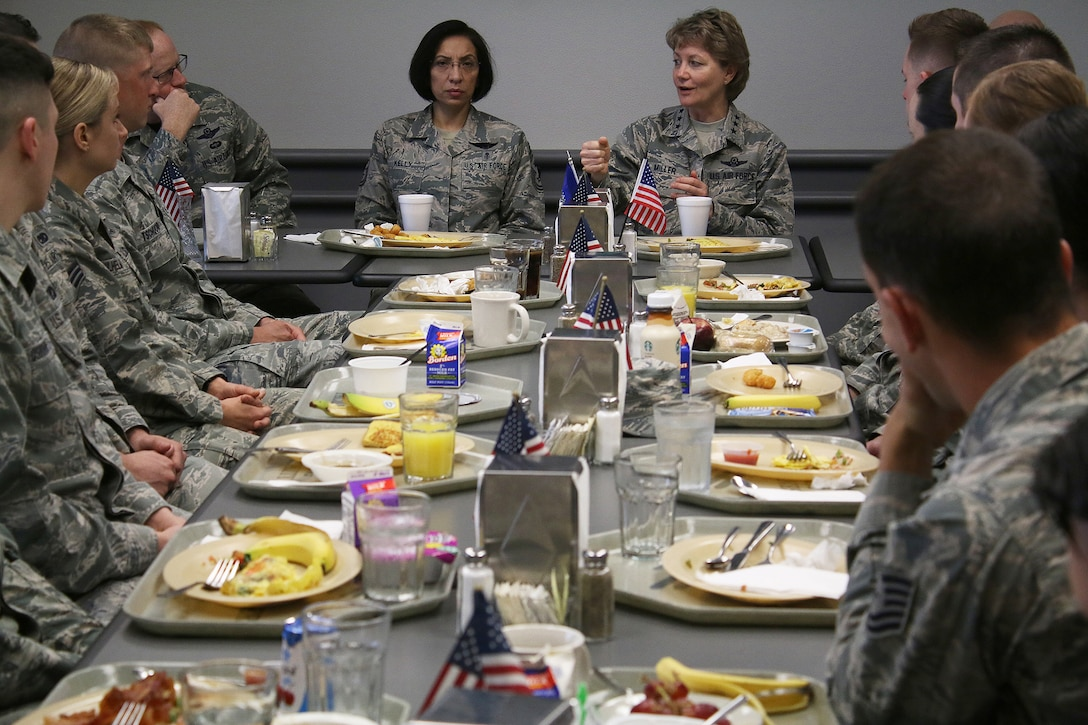 Lt. Gen. Maryanne Miller, Air Force Reserve Command commander and Chief of the Air Force Reserve, and Chief Master Sgt. Ericka Kelly, AFRC command chief, talk with 445th Airlift Wing Airmen during breakfast at the Pitsenbarger Dining Facility May 5, 2018