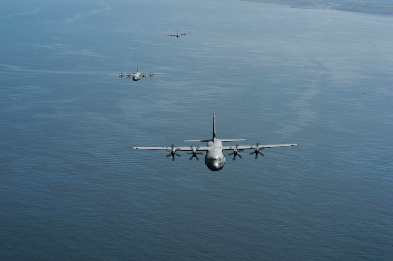 A formation of C-130J Super Hercules assigned to the 37th Airlift Squadron flies over the English Channel June 2, 2018. The 37th AS is a descendant unit of the 37th Troop Carrier Squadron, which dropped paratroopers over Normany on D-Day. (U.S. Air Force photo by Senior Airman Joshua Magbanua)