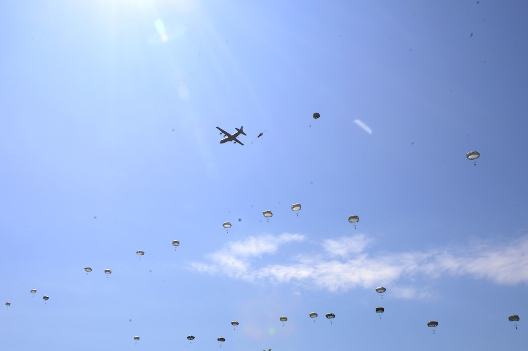 A U.S. Air Force C-130J Super Hercules drops paratroopers over Sainte-Mère-Église, France, June 3, 2018. U.S. and Allied aircraft conducted memorial airdrops to commemorate the Battle of Normandy in World War II. (U.S. Air Force photo by Senior Airman Joshua Magbanua)