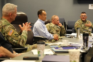 Army Maj. Gen. Richard Gallant, left, discusses response scenarios with attendees at the Joint Task Force Civil Support (JTF-CS) table top exercise May 15-16. More than 50 people from the Chemical, Biological, Radiological and Nuclear (CBRN) Response Enterprise (CRE) gathered here to rehearse responding to complex catastrophic disasters in the United States and its territories. JTF-CS provides command and control for designated Department of Defense specialized response forces to assist local, state, federal and tribal partners in saving lives, preventing further injury, and providing critical support to enable community recovery.  (Official Department of Defense photo by Mass Communication Specialist 3rd Class Michael Redd)