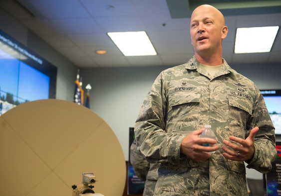 Col. Jeremy Boenisch, 5th Combat Communications Group commander, explains the 5th CCG's mission for civic leaders during a tour at Joint Base San Antonio-Lackland, Texas, May 31, 2018. The civic leaders visited the base with Gen. Mike Holmes, commander Air Combat Command, to introduce them to 24th Air Force's cyberspace mission and 25th AF's intelligence, surveillance and reconnaissance mission. (U.S. Air Force photo by Tech. Sgt. R.J. Biermann)