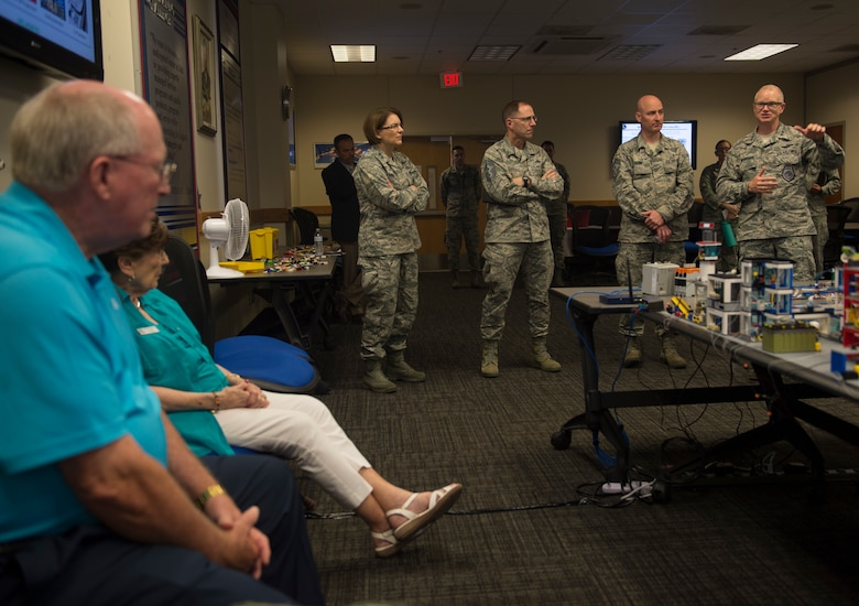 "Maj. Gen. Chris Weggeman, 24th Air Force commander (right), explains the purpose of the 90th Cyber Operations Squadron ""Bricks-in-the-Loop"" model to civic leaders during a tour at Joint Base San Antonio-Lackland, Texas, May 31, 2018. The model is used as a cyber training tool to teach cyber Airmen information technology and operational technology network defense. The tour was hosted to introduce attendees to 24th Air Force's cyberspace mission and 25th AF's intelligence, surveillance and reconnaissance mission. (U.S. Air Force photo by Tech. Sgt. R.J. Biermann)"