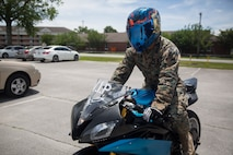 Cpl. James Hucks, motorcycle rider on Marine Corps Base Camp Lejeune, displays the proper safety gear to wear while riding a motorcycle to prevent injury on MCB Camp Lejeune, May 16.