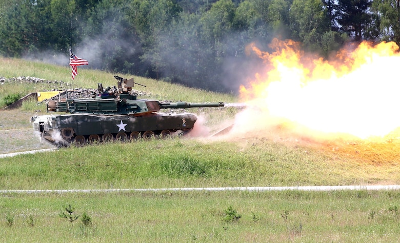 A tank from the 2nd Battalion, 70th Armor Regiment, 2nd Armored Brigade Combat Team, 1st Infantry Division fires