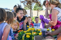 SCHRIEVER AIR FORCE BASE, Colo. – Children from the Child Development Center participate in activities during the 50th Force Support Squadron 1st anniversary celebration of the Event Center at Schriever Air Force Base, Colorado, June 1, 2018. The event featured new campers and other items for loan and rent from the Outdoor Recreation Office for the summer. Army and Air Force Exchange Service food vendors and other services also provided support for the event. (U.S. Air Force photo by Kathryn Calvert)