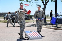 SCHRIEVER AIR FORCE BASE, Colo. - Tech. Sgt. Brett Tucker and Staff Sgt. Donald Montes, both with the 1st Space Operations Squadron, team up to play a game of cornhole during the 50th Force Support Squadron 1st anniversary celebration of the Event at Schriever Air Force Base, Colorado, June 1, 2018. The event center opened June 1, 2017, and has served as a place for leaders to host events and engage with Airmen in recreational activities. (U.S. Air Force photo by Kathryn Calvert)