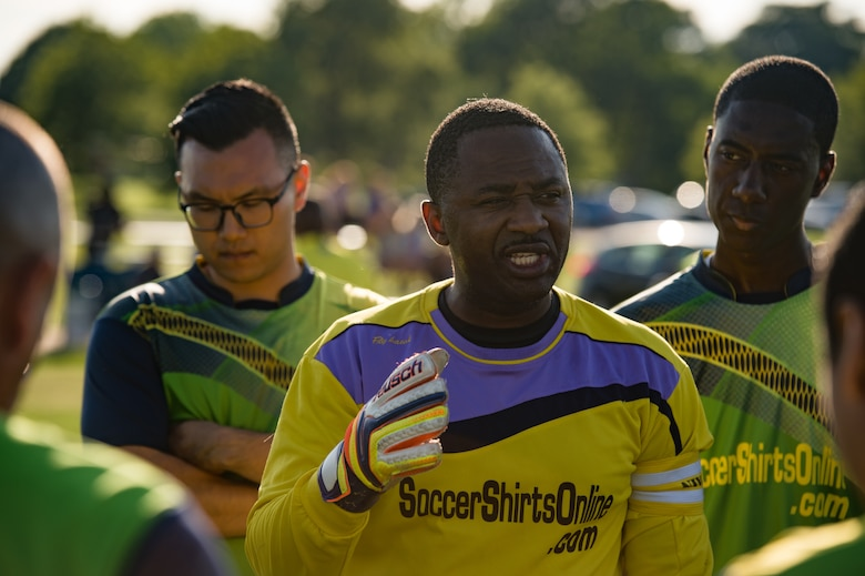 U.S. Air Force Staff Sgt. Elvis Eseh, 735th Supply Chain Operations Group team goalie, speaks to his team during the Intramural Soccer Championship at Joint Base Langley-Eustis, Virginia, June 4, 2018.