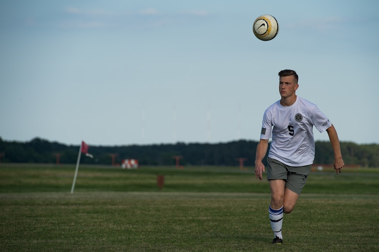 Ryan Andrews, 633rd Medical Group team defender, runs to the ball during the Intramural Soccer Championship at Joint Base Langley-Eustis, Virginia, June 4, 2018.