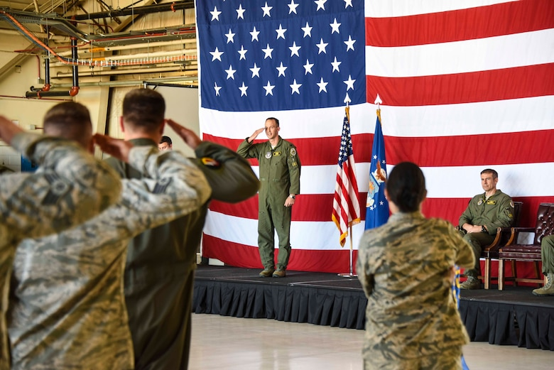Lt. Col. Benjamin Harrison receives his first salute as commander from members of the 466th Fighter Squadron