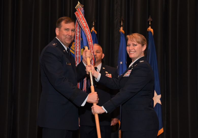 Col. Mona Alexander assumes command of the U.S. Air Force Expeditionary Operations School during a change of command ceremony held at Grace Patterson Hall at Joint Base McGuire-Dix-Lakehurst, June 5, 2018. (U.S. Air Force photo by Tech. Sgt. Jamie Powell)