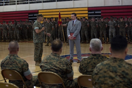 U.S. Marine Lt. Col. Bradley Bean, commanding officer of 2nd Radio Battalion, II Marine Expeditionary Force Information Group, gives his remarks about Sean-Paul Donovan, a former sergeant with 2nd Radio Battalion, II Marine Expeditionary Force Information Group, during an award ceremony at Camp Lejeune, N.C., May 17, 2018. The Navy and Marine Corps Medal is the highest non-combatant decoration awarded. Donovan received this award for saving the life of one of his fellow Marines. (U.S. Marine Corps photo by Lance Cpl. Tiana Boyd)