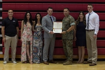 Sean-Paul Donovan, a former sergeant with 2nd Radio Battalion, II Marine Expeditionary Force Information Group is awarded the Navy and Marine Corps Medal at Camp Lejeune, N.C., May 17, 2018. The Navy and Marine Corps Medal is the highest non-combatant decoration awarded. Donovan received this award for saving the life of one of his fellow Marines. (U.S. Marine Corps photo by Lance Cpl. Tiana Boyd)