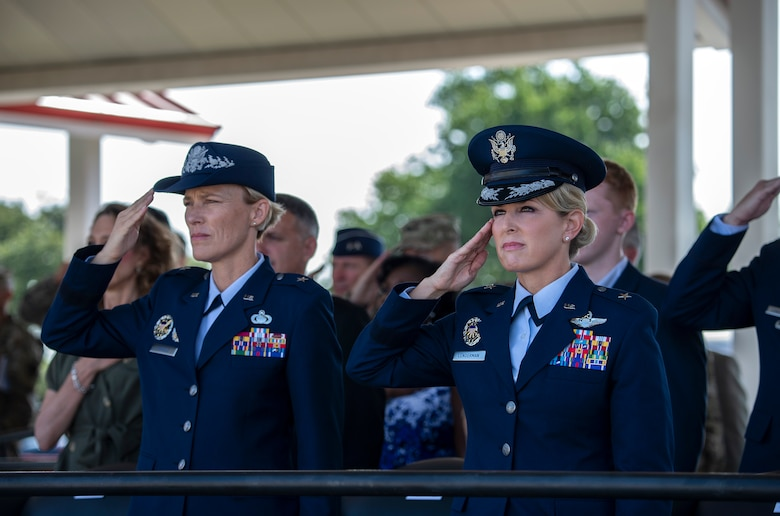 Brig. Gen. Heather Pringle, outgoing 502nd Air Base Wing and Joint Base San Antonio commander; and Brig. Gen. Laura L. Lenderman, incoming 502nd ABW and JBSA commander; salute during the change of command ceremony at JBSA-Fort Sam Houston's MacArthur Parade Field June 6, 2018. The change of command ceremony represents the formal passing of responsibility, authority and accountability of command from one officer to another. Pringle served as commander since August 2016.