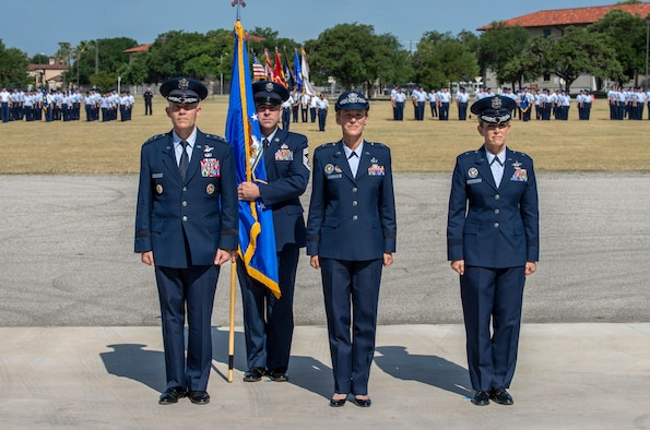 U.S Air Force Lt. Gen. Steve Kwast, commander of Air Education and Training Command and presiding official; Brig. Gen. Heather Pringle, outgoing 502nd Air Base Wing and Joint Base San Antonio commander; and Brig. Gen. Laura L. Lenderman, incoming 502nd ABW and JBSA commander; stand at attention during the change of command ceremony at JBSA-Fort Sam Houston's MacArthur Parade Field June 6, 2018. The change of command ceremony represents the formal passing of responsibility, authority and accountability of command from one officer to another. Pringle served as commander since August 2016.
