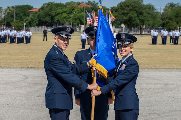 U.S Air Force Lt. Gen. Steve Kwast, commander of Air Education and Training Command, passes the guidon to Brig. Gen. Laura L. Lenderman during the 502nd Air Base Wing and Joint Base San Antonio change of command ceremony at JBSA-Fort Sam Houston's MacArthur Parade Field June 6, 2018. Members of the 502nd ABW provide installation support to 266 mission partners across 11 JBSA operating locations. Lenderman comes to JBSA from Scott Air Force Base, Illinois, where she was Deputy Director-Military, Strategic Plans, Policy and Logistics, U.S. Transportation Command.