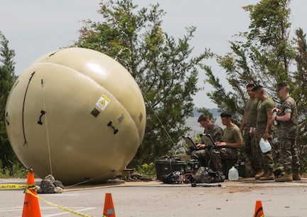 U.S. Marines with 2nd Radio Battalion, II Marine Expeditionary Force Information Group, set up network satellite communications through a Ground Antenna Transmit and Receive during a Command Post Exercise (CPX) at Camp Lejeune, N.C., May 21, 2018. 2nd Radio Battalion conducted the CPX to evaluate and improve their communication capabilities in preparation for an upcoming Mission Rehearsal Exercise. (U.S. Marine Corps photo by Lance Cpl. Tiana Boyd)