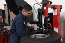 Airman 1st Class Jacobo Abeytia, 30th Logistics Readiness Squadron vehicle maintenance apprentice, completes a wheel during a routine tire change, May 29, 2018 at Vandenberg Air Force Base, Calif. A vehicle maintenance apprentice practices where an automobile is serviced on a regular basis to prevent a major breakdown or the need for major repair. (U.S. Air Force photo by Airman Aubree Milks/Released)