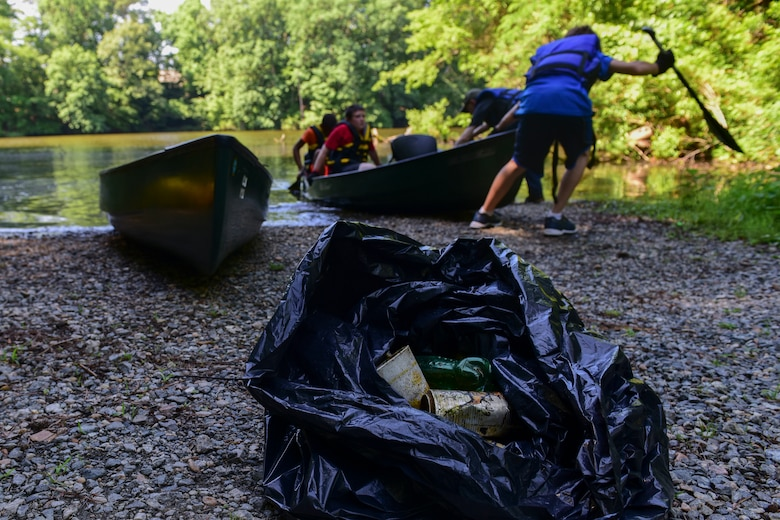 Fort Eustis Boy Scouts Troop 45 members pull a canoe out of Eustis Lake during a Clean the Bay at Joint Base Langley-Eustis, Virginia, June 2, 2018. The 733rd Civil Engineer Division Environmental Element hosted the event to help preserve parts of the Chesapeake Bay. (U.S. Air Force photo by Airman 1st Class Monica Roybal)