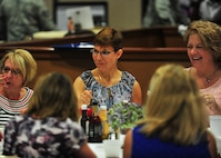 Jill La Fave, a 22nd Air Force Key Spouse and wife of Maj. Gen. Craig La Fave, 22nd AF commander, chats with 11 of the 910th Airlift Wing's Key Spouses during a luncheon at the Community Activities Center, June 2, here.