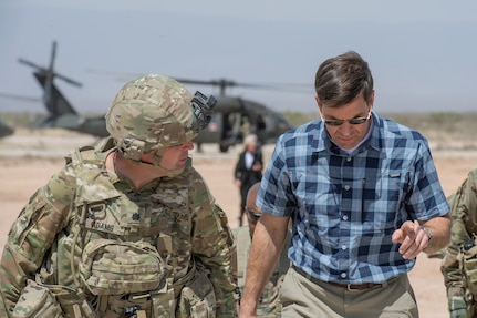 """Secretary of the Army Dr. Mark T. Esper speaks with a Soldier while visiting an Army installation. Esper recently laid out """"The Army Vision"""" through 2028 that will ensure America's Soldiers are able to fight and decisively win in any future battle."""