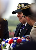 D-Day veteran John Roman prepares to lay a wreath of remembrance during the Utah Beach Federal Monument Ceremony in Sainte-Marie-Du-Mont, France.