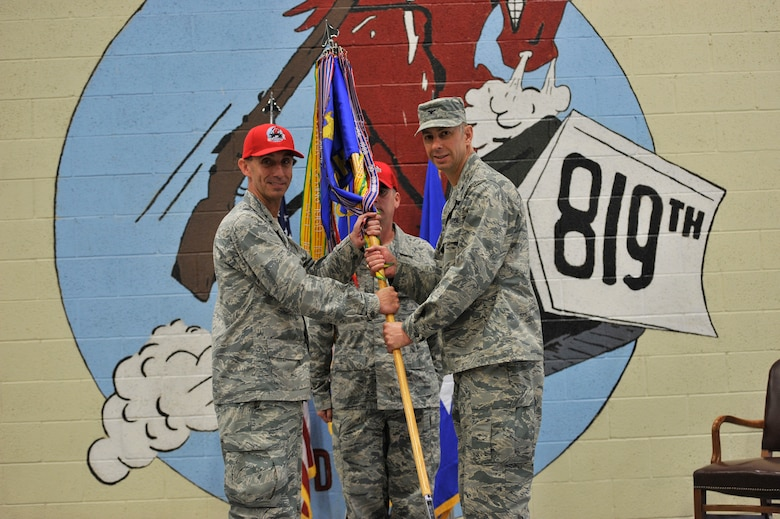 U.S. Air Force Col. Jason Loschinskey, right, assumes command of the 819th Rapid Engineer Deployable Heavy Operational Repair Squadron Engineers (RED HORSE) from Maj. Gen. Scott J. Zobrist, 9th Air Force commander, as Senior Master Sgt. Craig Houchins, 819th RHS guidion bearer, looks on during a ceremony at Malmstrom Air Force Base, Mont., June 6, 2018. Loschinskey was previously the deputy commander for the 71st Mission Support Group at Vance AFB, Calif. The 819th RHS is a self-sufficient, 240-person mobile squadron capable of rapid response and independent operations in remote, austere environments worldwide.  (U.S. Air Force photo by John Turner)