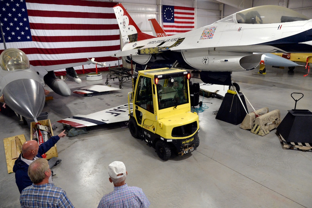 Hill Aerospace Museum staff and volunteers reposition an F-16 wing to be installed on a static display aircraft May 29, 2018, at Hill Air Force Base, Utah. Now located at the east end of the museum's fighter gallery, the former Thunderbird F-16A aircraft will be on display for visitors. (U.S. Air Force photo by Todd Cromar)